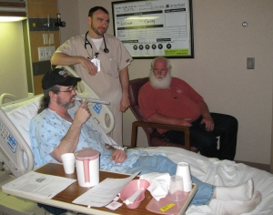 Randy, Louie's boss looks on as he has a breathing treatment  Photo by Tracey Lewis